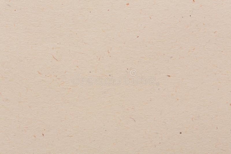 Vecchio fondo di carta marrone con la disposizione d'annata di struttura, il bianco sporco o il colore del fondo della crema fotografia stock libera da diritti