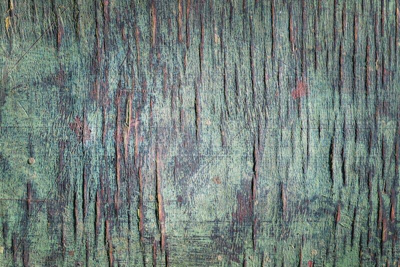 Vecchio fondo di legno dipinto incrinato dell'impiallacciatura Struttura naturale stagionata del compensato con pittura e la crep fotografie stock libere da diritti