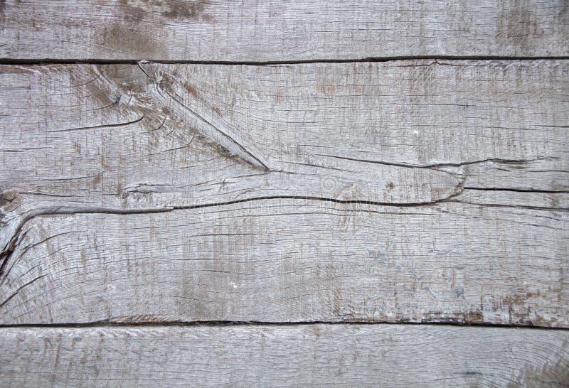 Vecchio fondo di legno incrinato, struttura di legno dipinta misera, bordo irregolare grigio chiaro, vecchia fine rustica natural fotografie stock