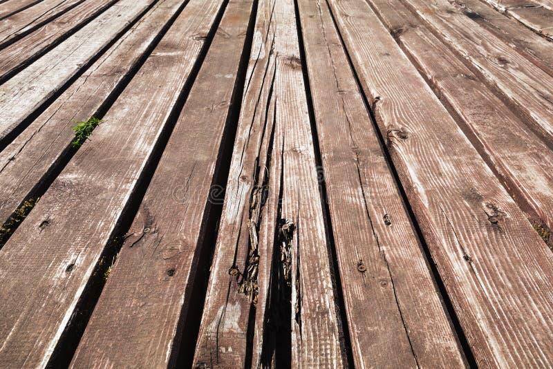Vecchio fondo di legno marrone nocivo del pavimento fotografie stock libere da diritti