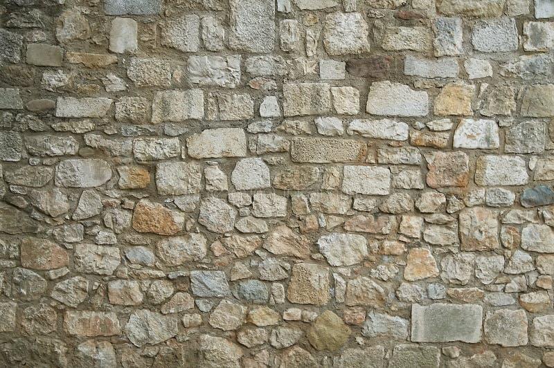 Vecchio fondo di struttura della parete di pietra del granito fotografia stock libera da diritti