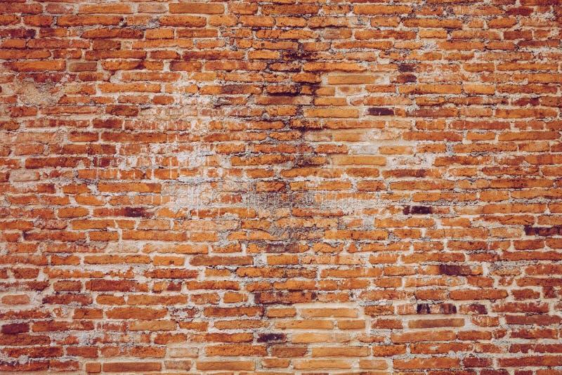 Vecchio fondo indossato rosso di struttura del muro di mattoni della parete del tempio Vinta fotografie stock libere da diritti