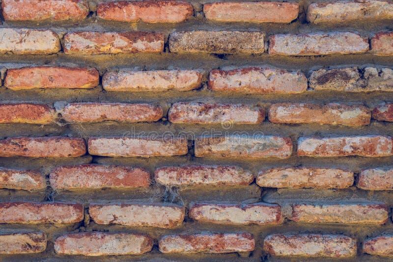 Vecchio fondo indossato rosso di struttura del muro di mattoni Effetto d'annata fotografia stock