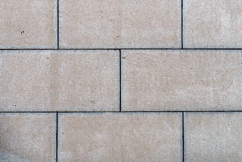 Vecchio grande fondo di struttura del muro di mattoni o del sentiero per pedoni del blocco in calcestruzzo fotografia stock libera da diritti