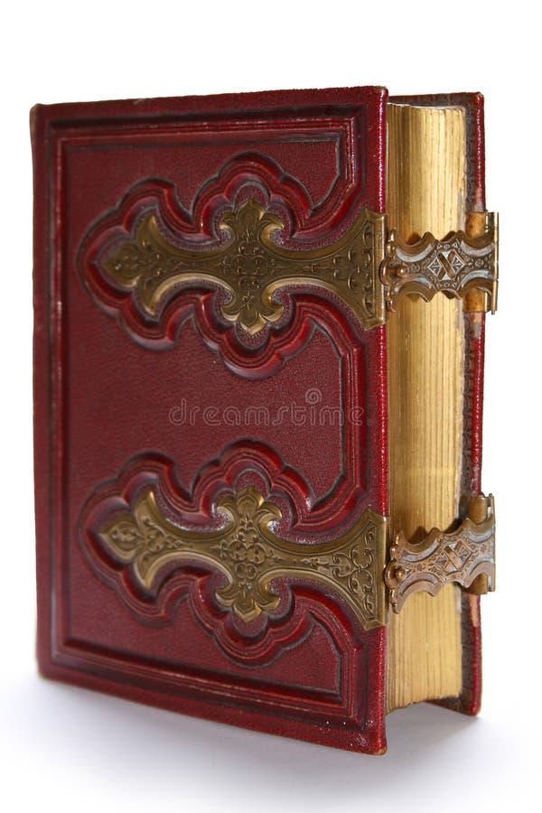 Vecchio libro antico rosso scuro fotografia stock