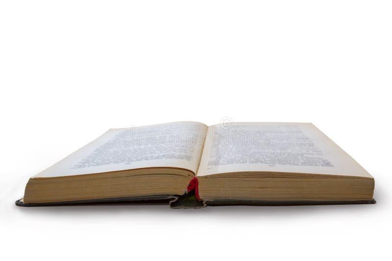 Vecchio libro aperto isolato su priorità bassa bianca immagine stock
