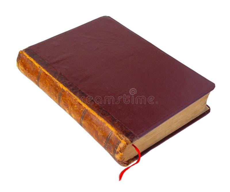 Vecchio libro marrone chiuso con il segnalibro rosso fotografia stock libera da diritti