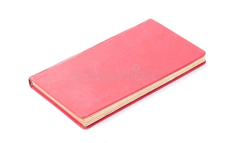 Vecchio libro rosso chiuso isolato fotografia stock libera da diritti