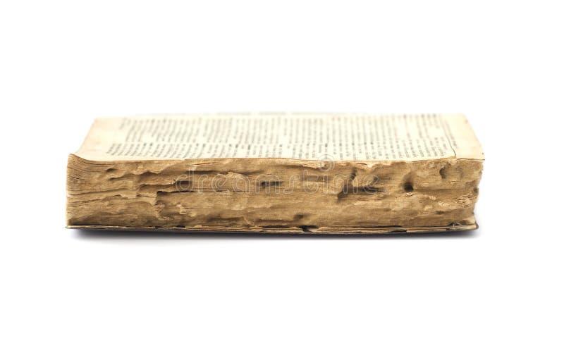 Vecchio libro rovinato dalla termite fotografia stock