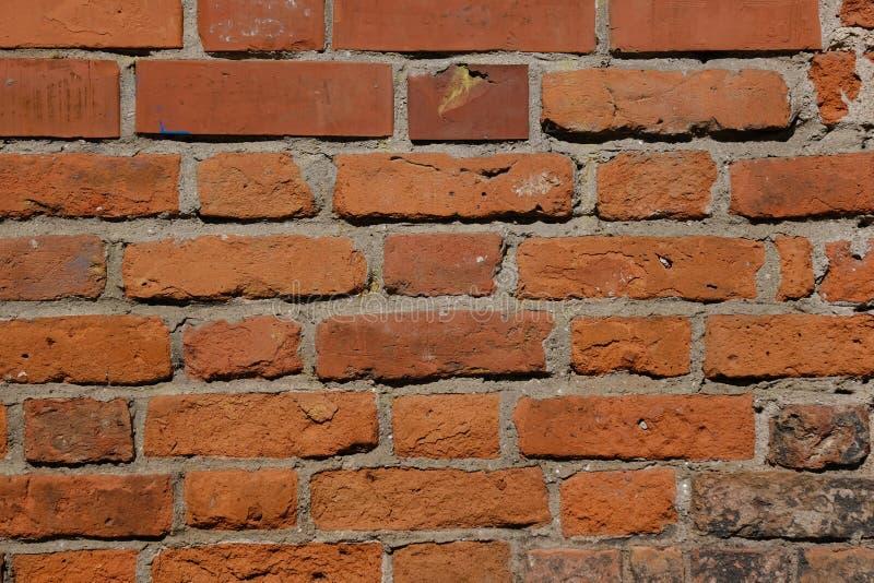 Vecchio muro di mattoni arancione muro di mattoni, struttura della muratura, fondo del modello della muratura fotografia stock libera da diritti