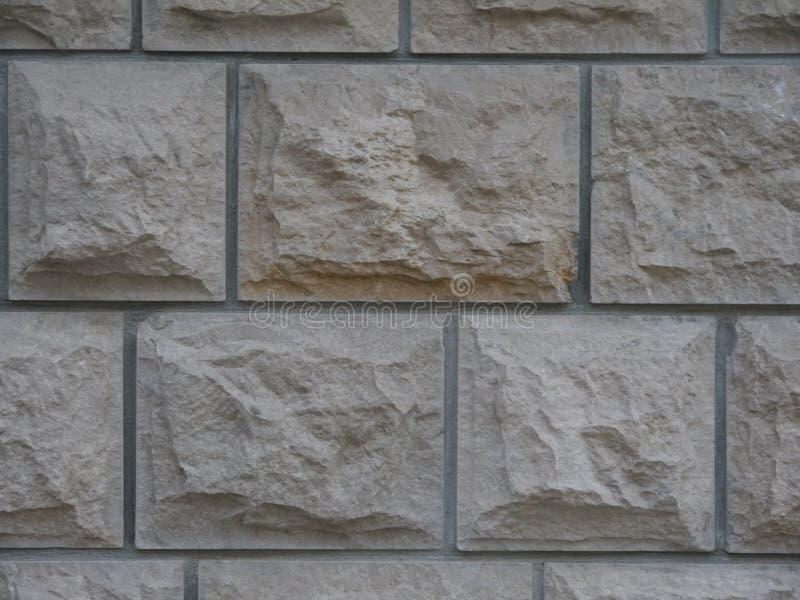 Vecchio muro di mattoni di pietra grigio fotografia stock libera da diritti