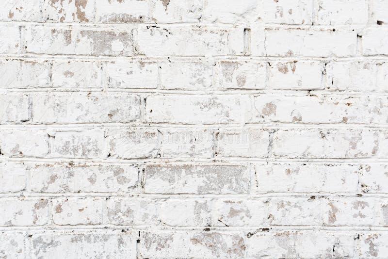 Vecchio muro di mattoni dipinto struttura, muratura irregolare nociva, fondo astratto fotografia stock libera da diritti