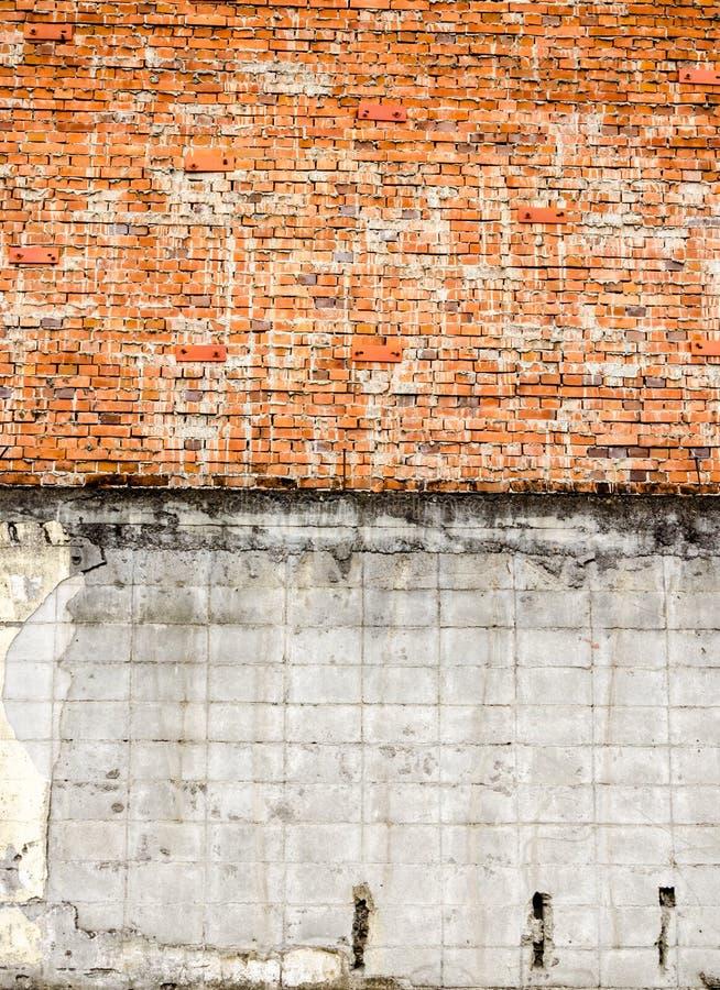 Vecchio muro di mattoni in un'immagine di sfondo: fondo di lerciume fotografie stock