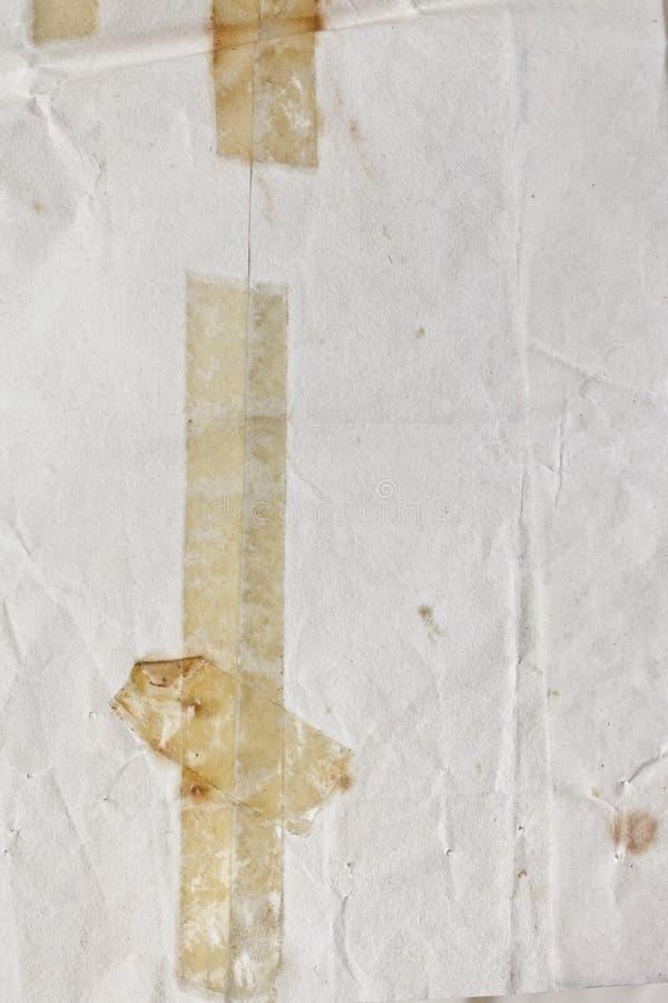 Vecchio nastro su fondo di carta immagini stock