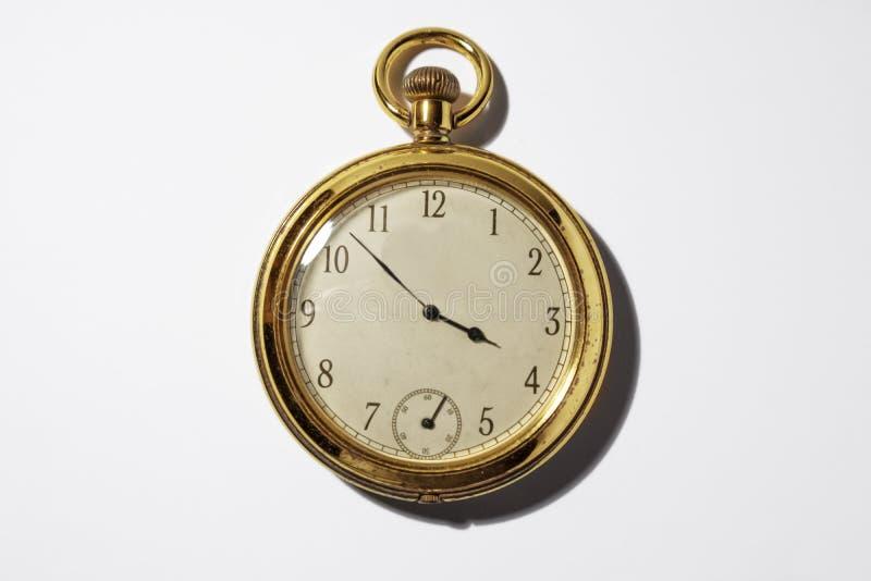 Vecchio orologio da tasca dorato immagine stock