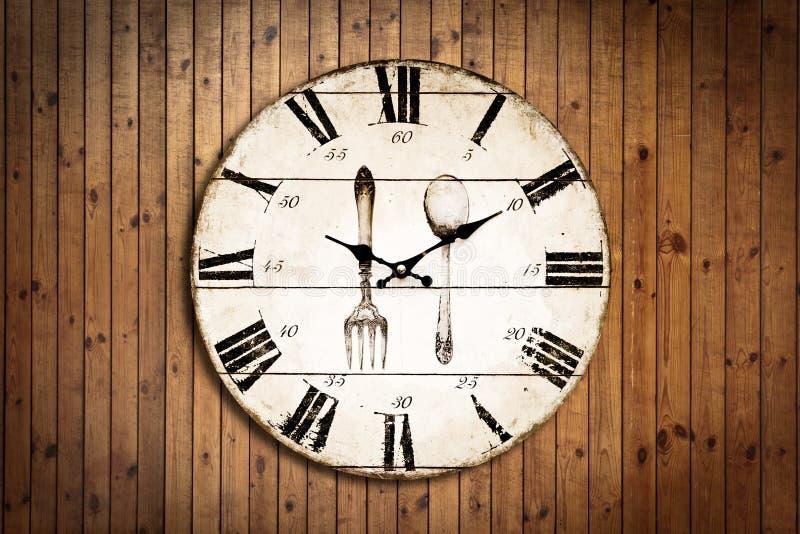 Vecchio orologio su struttura di legno del grung fotografia stock