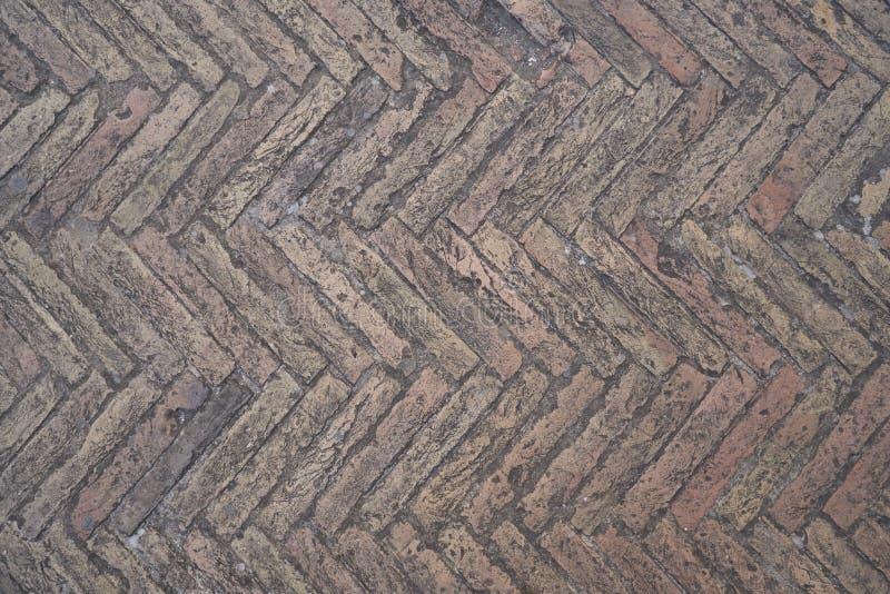 Vecchio pavimento di pietra sotto forma di parquet fotografia stock libera da diritti