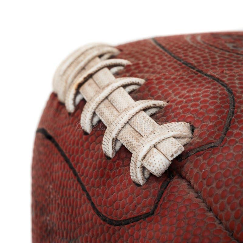 Vecchio primo piano Grimy di gioco del calcio - su bianco fotografia stock libera da diritti