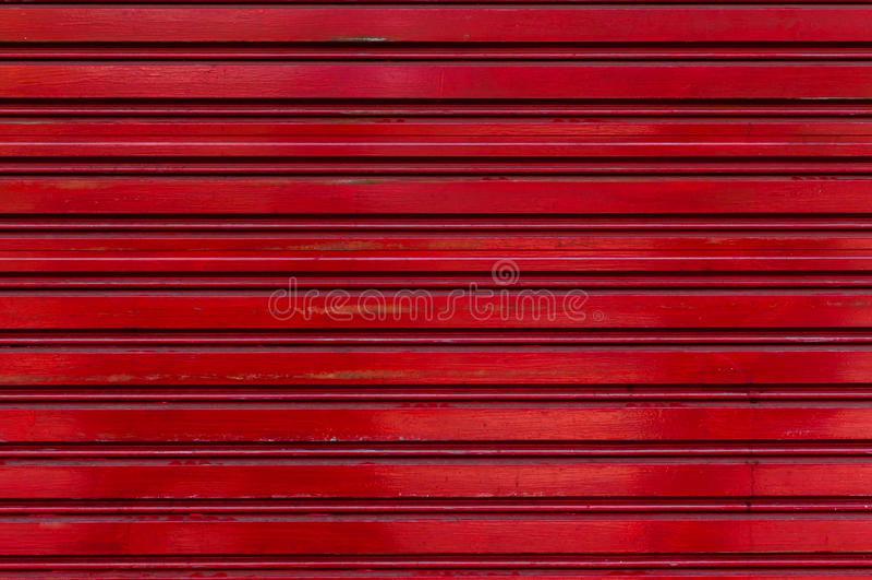 Vecchio quadrato di alluminio rosso scuro del metallo del fondo di struttura fotografie stock libere da diritti