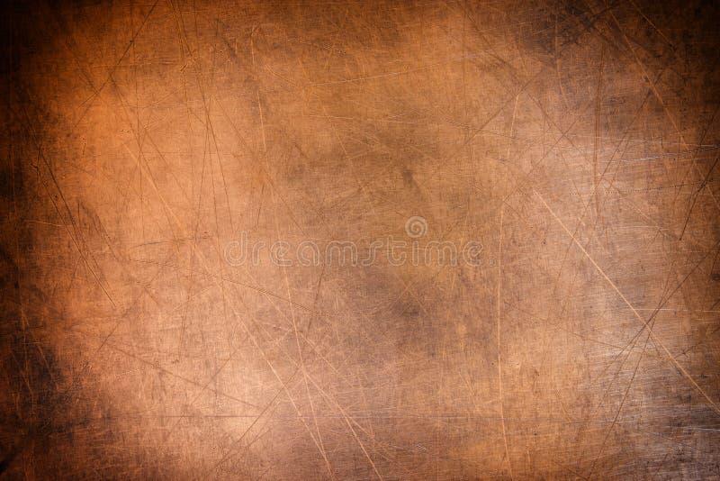 Vecchio rame di piastra metallica e spazzolato di struttura, fondo bronzeo immagini stock