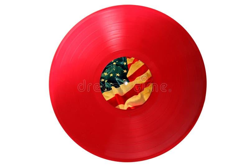 Vecchio record di vinile rosso con la bandierina degli S.U.A. immagini stock