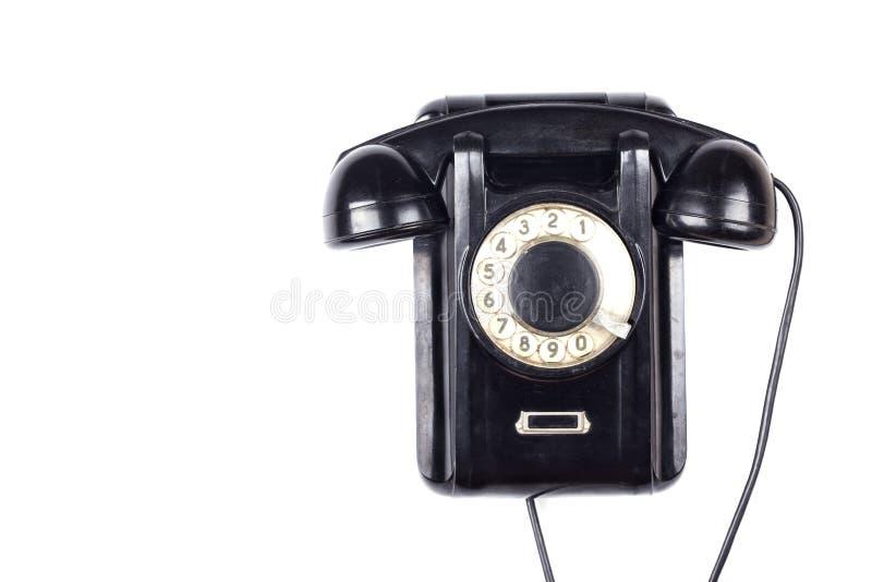 Vecchio retro telefono d'annata obsoleto nero isolato su fondo bianco fotografie stock libere da diritti