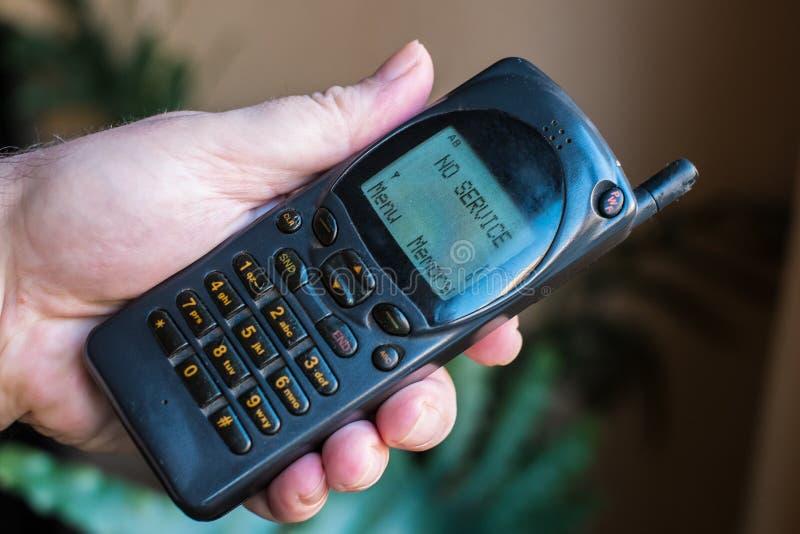 Vecchio telefono cellulare con fotografie stock libere da diritti