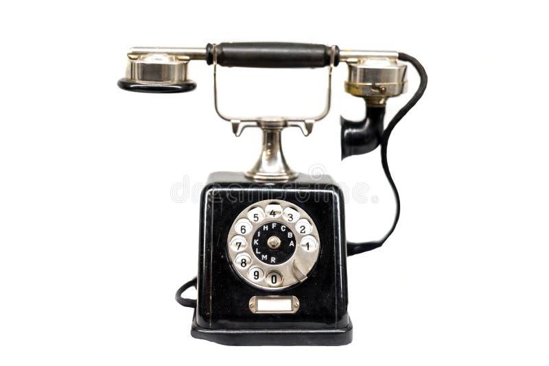 Vecchio telefono contro fondo isolato bianco fotografie stock