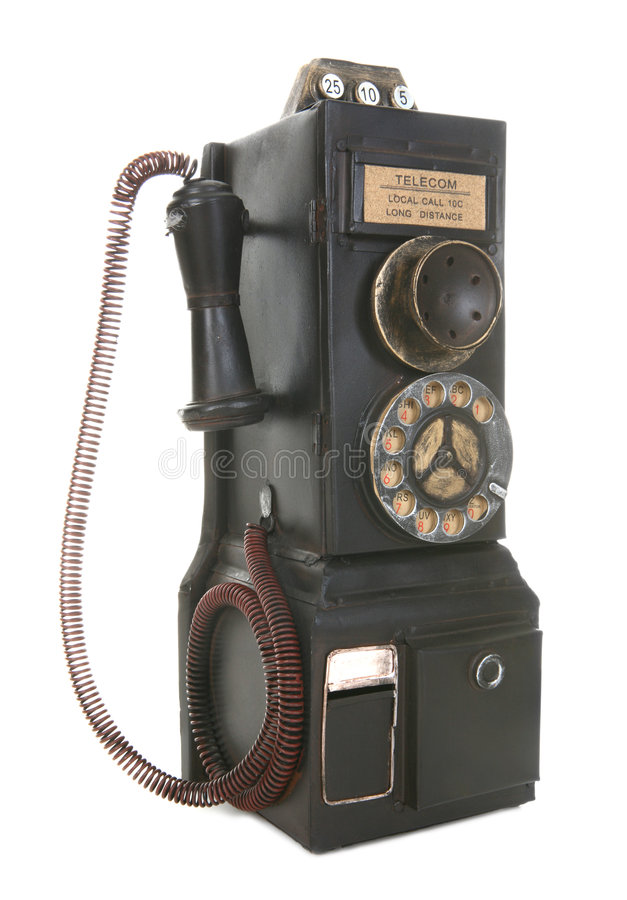 Vecchio telefono di paga dell'annata immagine stock