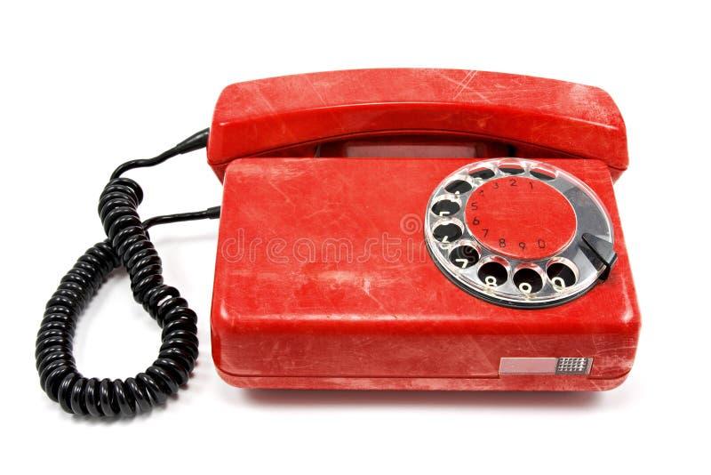 Vecchio telefono rosso sporco fotografia stock libera da diritti