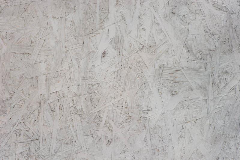 Vecchio textur orientato di legno dipinto del fondo del bordo OSB del filo immagine stock
