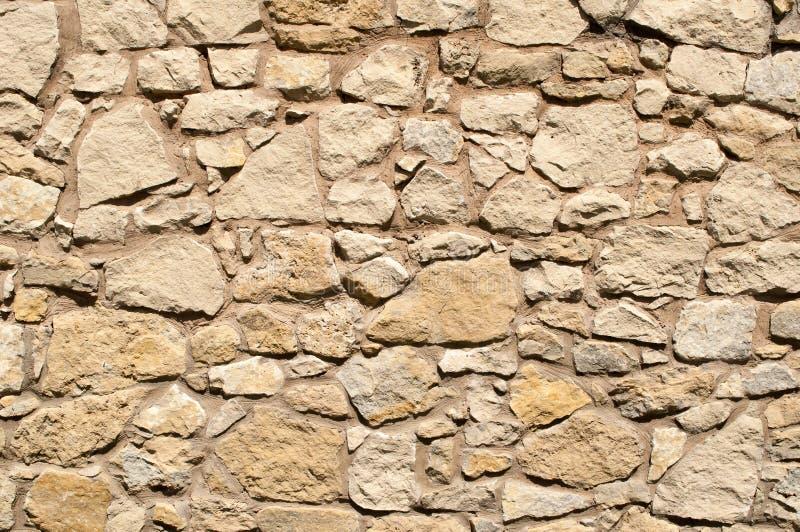 Vecchio tono marrone chiaro della parete di pietra fotografia stock libera da diritti