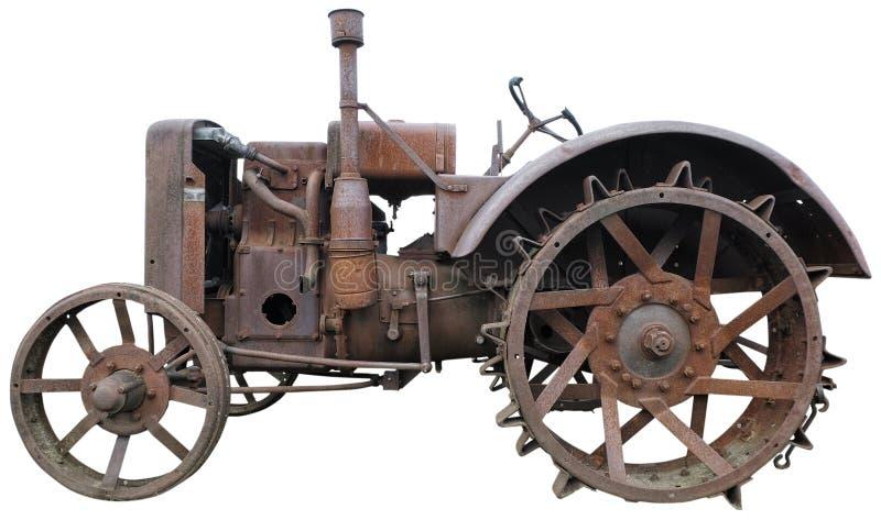 Vecchio trattore arrugginito isolato fotografia stock libera da diritti