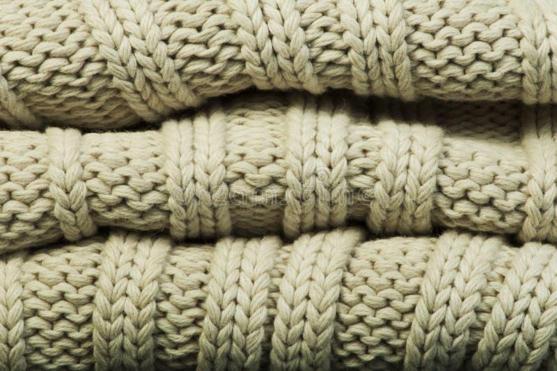 Vecchio tricotti il fondo del maglione fotografia stock