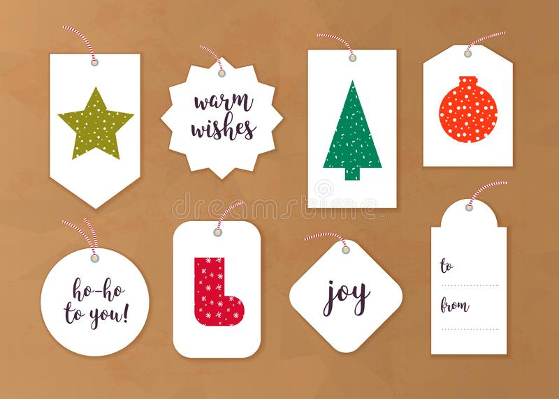 Vector collection of christmas gift tags and badges different shapes isolated on paper background. royalty free illustration