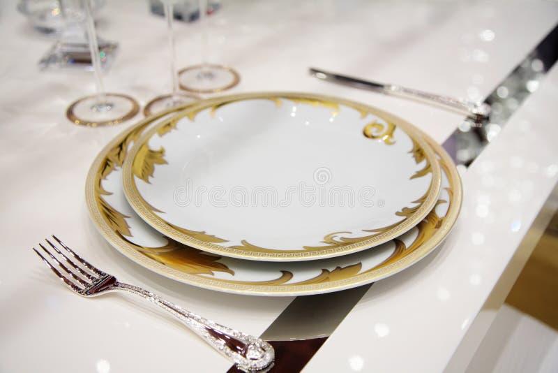 Vector con los platos de la cena fotos de archivo