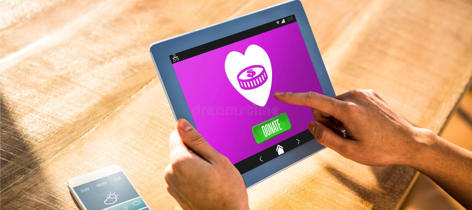 Composite image of icon of donation. Vector icon of donation against over shoulder view of casual man using tablet stock photos