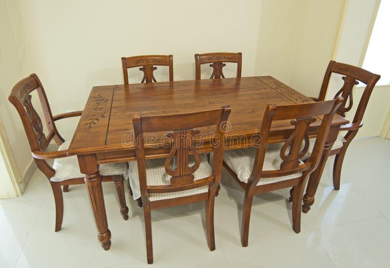 Vector y sillas de madera de cena imagen de archivo libre de regalías