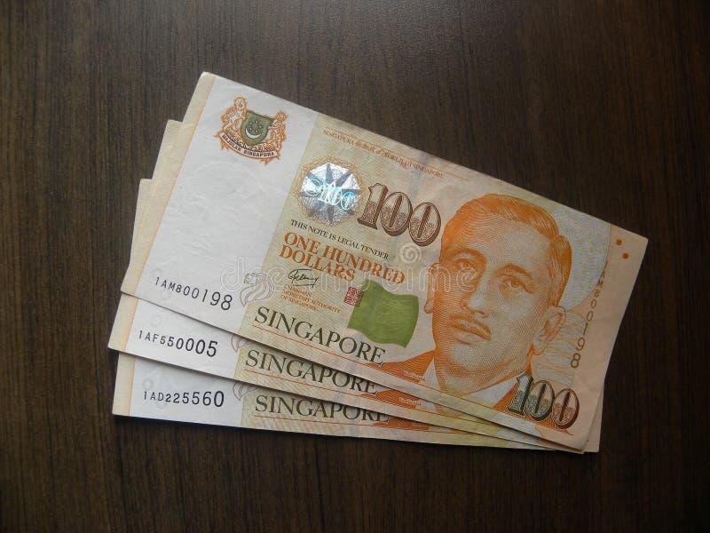 Veel bankbiljet van 100 dollarssingapore stock afbeeldingen