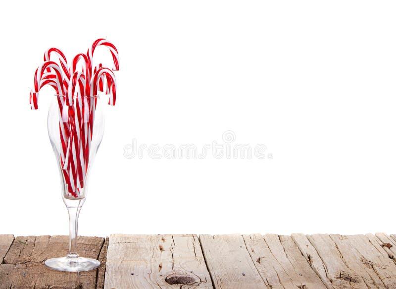 Veel riet van het Suikergoed in een wijnglas stock foto's