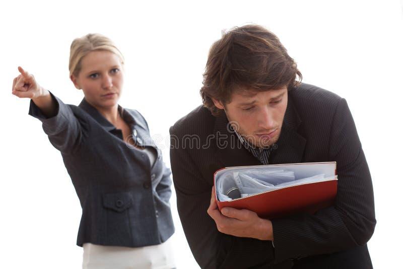 Veeleisende werkgever stock fotografie