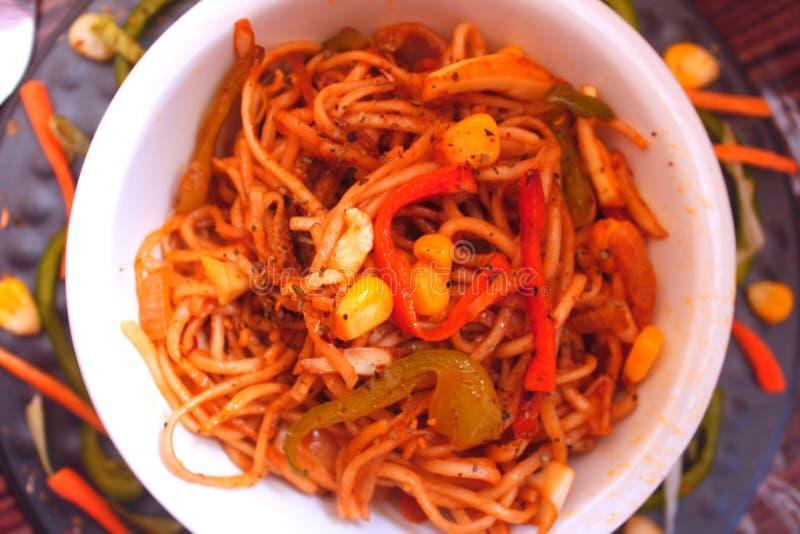 Veg noodles in a bowl stock photos
