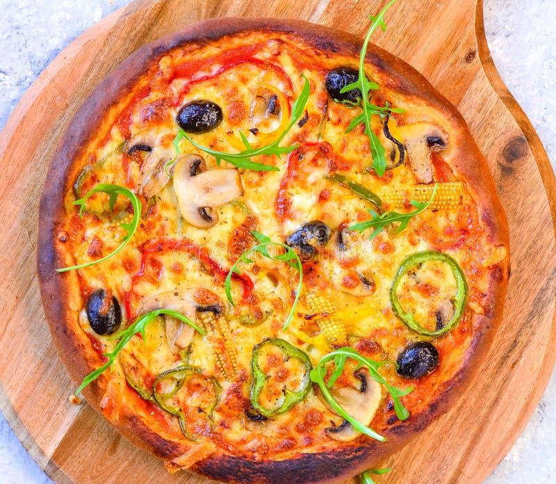 Italian Vegetarian pizza on round wooden  board stock photo