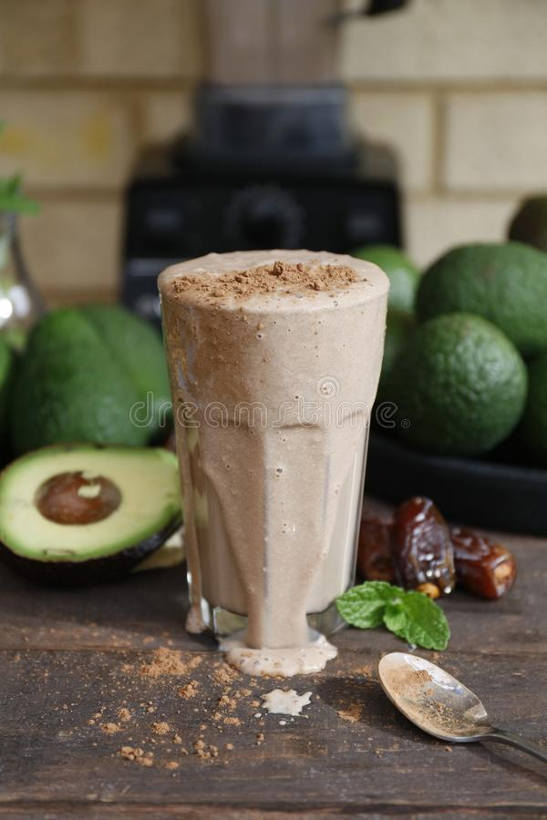 Vegan avocado milkshake with medjool dates royalty free stock images