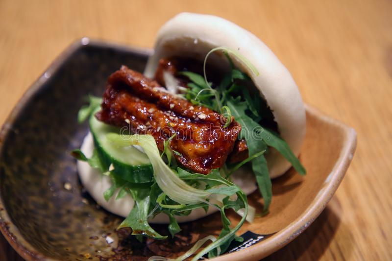 Asian Vegan Bao from Momotoko Restaurant in Espoo, Finland. Vegan bao from Asian restaurant Momotoko. Traditional Asian food with  steam cooked bun and filled stock photo