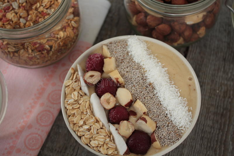 Vegan Breakfast banana smoothie with Chia, coconut, cherries, nuts, oatmeal. Start your morning with vitamins stock photos