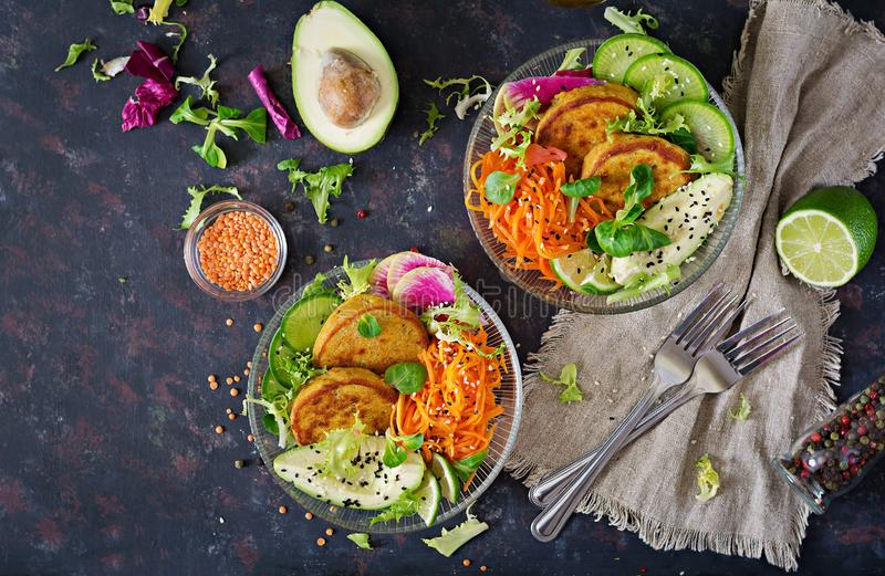 Vegan buddha bowl dinner food table. Healthy food. Healthy vegan lunch bowl. Fritter with lentils and radish, avocado, carrot sala stock images