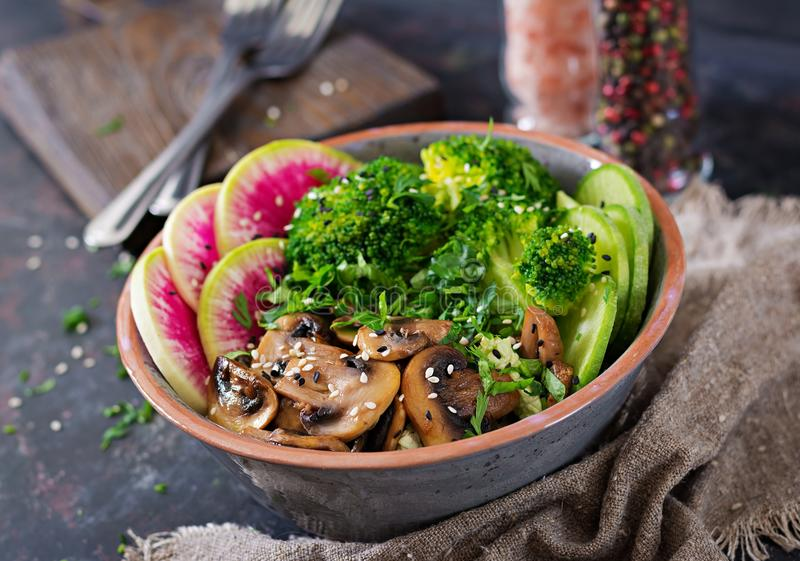 Vegan buddha bowl dinner food table. Healthy vegan lunch bowl. Grilled mushrooms, broccoli, radish salad. Vegan buddha bowl dinner food table. Healthy food royalty free stock photo