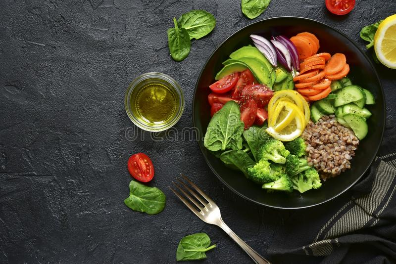 Vegan buddha bowl with vegetables and cereals. Healthy and balanced food concept. stock photo