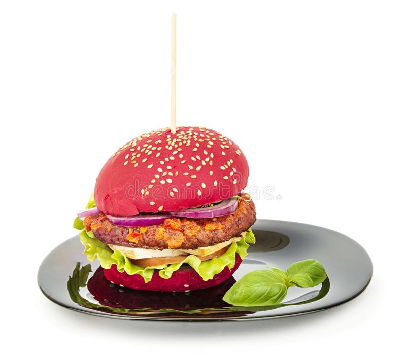 Vegan burger with red bun on a plate stock photography